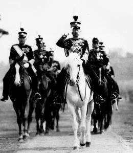 FILE - In this 1937 file photo, Japan's Emperor Hirohito salutes from his mount, his favorite white horse, during a military review in Tokyo. The original recording of Japan's Emperor Hirohito's war-ending speech has come back to life in digital form. The original sound was released Saturday, Aug. 1, 2015 by the Imperial Household Agency in digital format, ahead of the 70th anniversary of the speech and the war's end. (AP Photo/File)